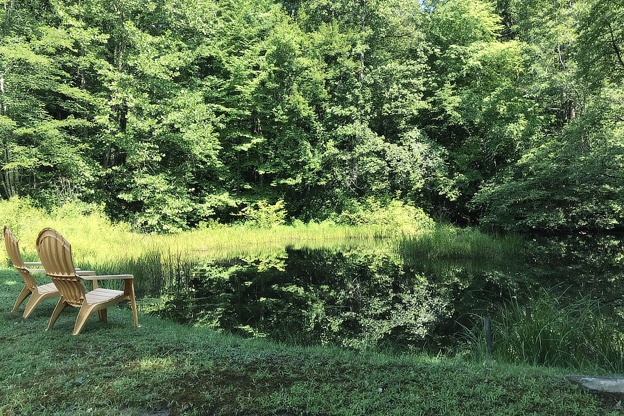 Pond with chairs